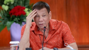 In this photo provided by the Malacanang Presidential Photographers Division, Philippine President Rodrigo Duterte attends a meeting at the Malacanang presidential palace in Manila, Philippines on Monday Oct. 19, 2020. (Robinson Ninal Jr./Malacanang Presidential Photographers Division via AP)