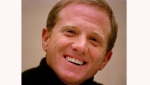 James Redford, son of actor Robert Redford, laughs during a press conference on Nov. 18, 1998. (AP Photo/Dave Weaver, File)