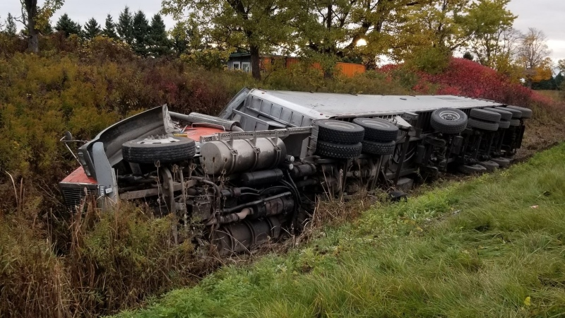 A transport rolled into a ditch along Highway 402 in Middlesex County on Tuesday, Oct. 20, 2020. (OPP Twitter)