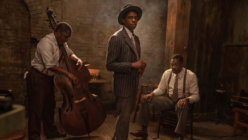 "This image released by Netflix shows Michael Potts, from left, Chadwick Boseman and Colman Domingo in ""Ma Rainey's Black Bottom."" Netflix on Monday previewed George C. Wolfe's August Wilson adaptation ""Ma Rainey's Black Bottom,"" showcasing Chadwick Boseman's final performance opposite Viola Davis' powerhouse blues singer. (David Lee/Netflix via AP)"