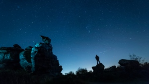 In this photo, the Orionid meteor shower is seen over Brimham Rocks in Yorkshire, England. (Danny Lawson/PA Images/Getty Images/CNN)
