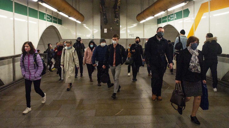 Passengers wearing face masks walk in the corridor of a metro station on Oct. 13 in Prague. (Michal Cizek/AFP/Getty Images/CNN)