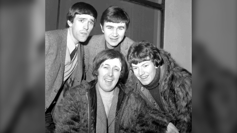 "In this Jan. 10, 1966 file photo, members of the band, the Spencer Davis Group, from top left: Muff Winwood, Pete York and Steve Winwood and Spencer Davis, foreground. British guitarist and bandleader Spencer Davis, whose eponymous rock group had 1960s hits including ""Gimme Some Lovin'"" and ""I'm a Man,"" has died at the age of 81. Davis' agent, Bob Birk, said Tuesday, Oct. 20, 2020 that he died in a hospital while being treated for pneumonia. (AP Photo, File)"