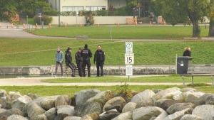 Police were seen looking for evidence and talking to people near Kits Point after human remains were found in a recycling bin.