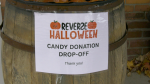 "The candy donation barrel in front of the Firehall Theatre in Gananoque, Ont., for donations towards the ""reverse Halloween"" idea this year. (Nate Vandermeer / CTV News Ottawa)"