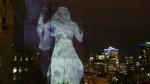 Suzanne, Leonard Cohen's muse, floats above the St. Lawrence in this Cité Mémoire projection. (Source: Into the Light with Cité Mémoire / Facebook)