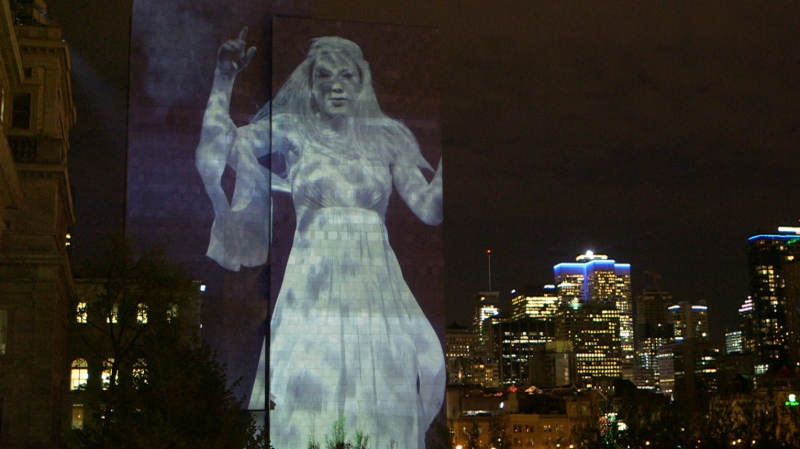 Suzanne, Leonard Cohen's muse, floats above the St. Lawrence in this Cité Mémoire projection. (Source: Into the Light with Cité Mémoire / Facebook)