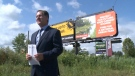 Billboards purchased by Windsor West MP Brian Masse were not removed once the election was called violating rules. (Rich Garton/CTV Windsor)
