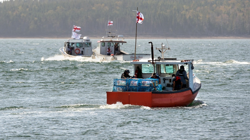 Members of the Potlotek First Nation, head out into St. Peters Bay from the wharf in St. Peter's, N.S. as they participate in a self-regulated commercial lobster fishery on Thursday, Oct. 1, 2020, which is Treaty Day. THE CANADIAN PRESS /Andrew Vaughan