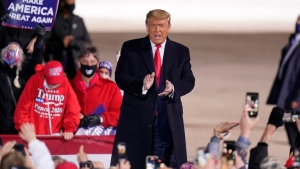 U.S. President Donald Trump arrives for a campaign rally at Erie International Airport, Tom Ridge Field in Erie, Pa, Tuesday, Oct. 20, 2020. (AP Photo/Gene J. Puskar)