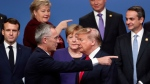 In this Dec. 4, 2019, file photo, NATO Secretary General Jens Stoltenberg, front left, speaks with U.S. President Donald Trump, front right, after a group photo at a NATO leaders meeting at The Grove hotel and resort in Watford, Hertfordshire, England. (AP Photo/Francisco Seco, File)