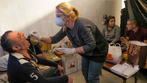 A medical worker collects a sample for COVID-19 inside a bomb shelter in Stepanakert, the separatist region of Nagorno-Karabakh, Tuesday, Oct. 20, 2020. (AP Photo)