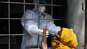 India has recorded more than 7.5 million infections of COVID-19, second only to the United States. (Money Sharma/AFP)