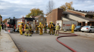 Fire crews clean up the scene following an apartment fire in Minto, Ont. on Tuesday, Oct. 20, 2020. (OPP Twitter)