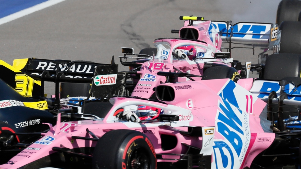 Racing Point driver Sergio Perez of Mexico, front, followed by Racing Point driver Lance Stroll of Canada, top, steers his car during the Russian Formula One Grand Prix, at the Sochi Autodrom circuit, in Sochi, Russia, Sunday, Sept. 27, 2020. (Yuri Kochetkov, Pool Photo via AP)