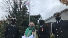 Members of HMCS Prevost, the London naval reserve station, stand with Lucienne de Vries, the 'Flag Lady' of Sarnia, Ontario on Wednesday, October 21, 2020 (Sean Irvine CTV News)