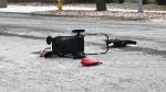 An empty stroller was on its side on the road after a witness said it was hit by a vehicle Wednesday morning.