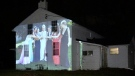 A photo is projected onto the historic Clarke House in London, Ont. on Tuesday, Oct. 20, 2020. (Jim Knight / CTV News)
