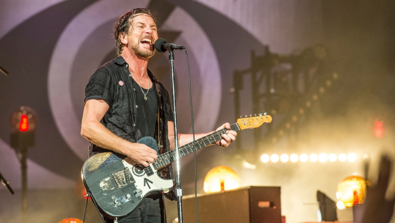 Eddie Vedder of Pearl Jam performs at Bonnaroo Music and Arts Festival in Manchester, Tenn. on June 11, 2016. Pearl Jam has encouraged fans to vote and asks them to take a pledge to try and mail-in their ballots. Vedder posted step-by-step photos on his Instagram page on how to vote by mail. (Photo by Amy Harris/Invision/AP, File)