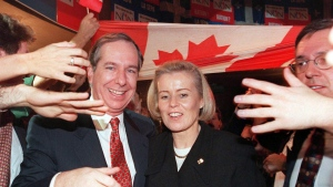 Quebec Liberal leader Daniel Johnson makes his way through a crowd of supporters with his wife Suzanne Marcil after the No victory in the Quebec referendum Monday night in Montreal. (CP PHOTO) 1995) 1995 (Jacques Boissinot)