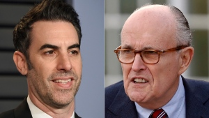 Sacha Baron Cohen arrives at the Vanity Fair Oscar Party in Beverly Hills, Calif., on March 4, 2018, left, and former New York Mayor Rudy Giuliani at the Trump National Golf Club Bedminster clubhouse in Bedminster, N.J. on Nov. 20, 2016. (AP Photo)