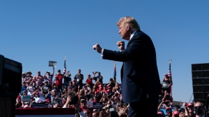 "In this Oct. 19, 2020 photo, President Donald Trump dances to ""YMCA,"" after speaking at a campaign rally at Prescott Regional Airport, in Prescott, Ariz. (AP Photo/Alex Brandon)"