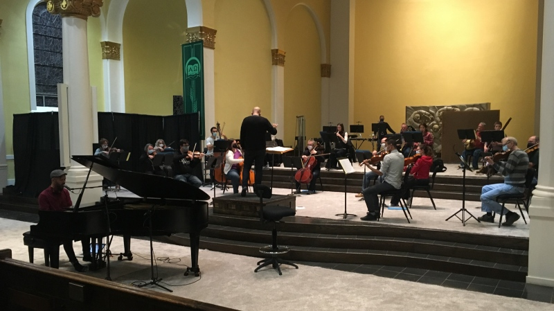 The Regina Symphony Orchestra rehearses at the Holy Rosary Cathedral. The church is hosting performances in the orchestra's Masterworks Series. (Cole Davenport/CTV News)