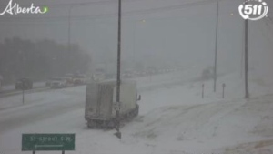 The province's traffic camera shows extremely poor driving conditions near the city of Medicine Hat Wednesday afternoon. (Supplied/511 Alberta)