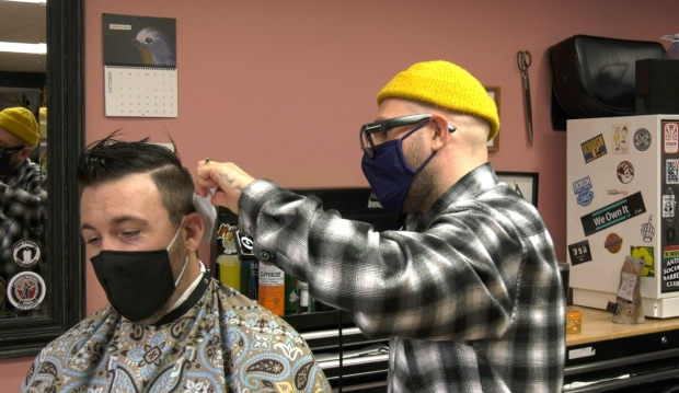 Jimmy Giroux, co-owner of Collective Haus Salon and Barbershop, is offering free haircuts Wednesday and Thursday to essential workers. (Jaime McKee/CTV News)