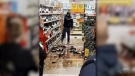 Cellphone footage shows a man smashing wine and liquor bottles on the floor of a supermarket in Ireland.