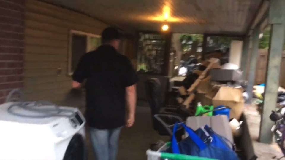Video posted on YouTube shows members of Clean Up Maple Ridge evicting a woman from a home in the city.