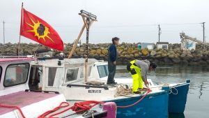 Indigenous fishers adjust lines on their boat in Saulnierville, N.S. on Wednesday, Oct. 21, 2020. Tensions remain high over an Indigenous-led lobster fishery that has been the source of conflict with non-Indigenous fishers. THE CANADIAN PRESS /Andrew Vaughan