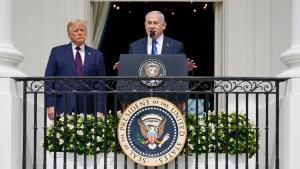 In this Sept. 15, 2020 file photo, Israeli Prime Minister Benjamin Netanyahu speaks as U.S. President Donald Trump looks on, during the Abraham Accords signing ceremony on the South Lawn of the White House in Washington. (AP Photo/Alex Brandon, File)