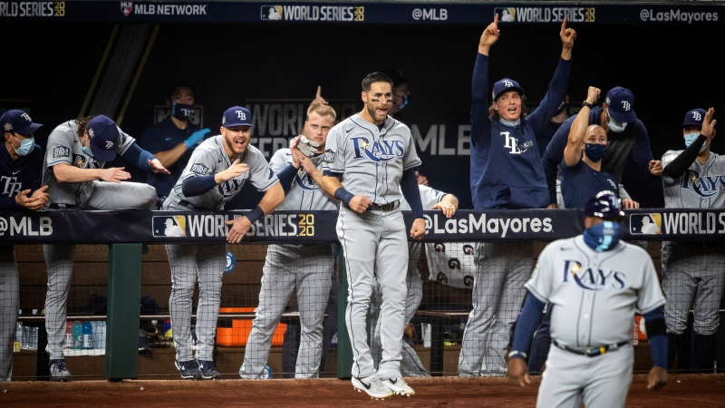 The Tampa Bay Rays celebrate after a home run against the Los Angeles Dodgers during Game 2 of the baseball World Series, Wednesday, Oct. 21, 2020, in Arlington, Texas. (Yffy Yossifor/Star-Telegram via AP)