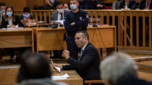 Former Golden Dawn lawmaker Iias Kasidiaris speaks during a Golden Dawn trial, in Athens, on Oct. 21, 2020. (Petros Giannakouris / AP)