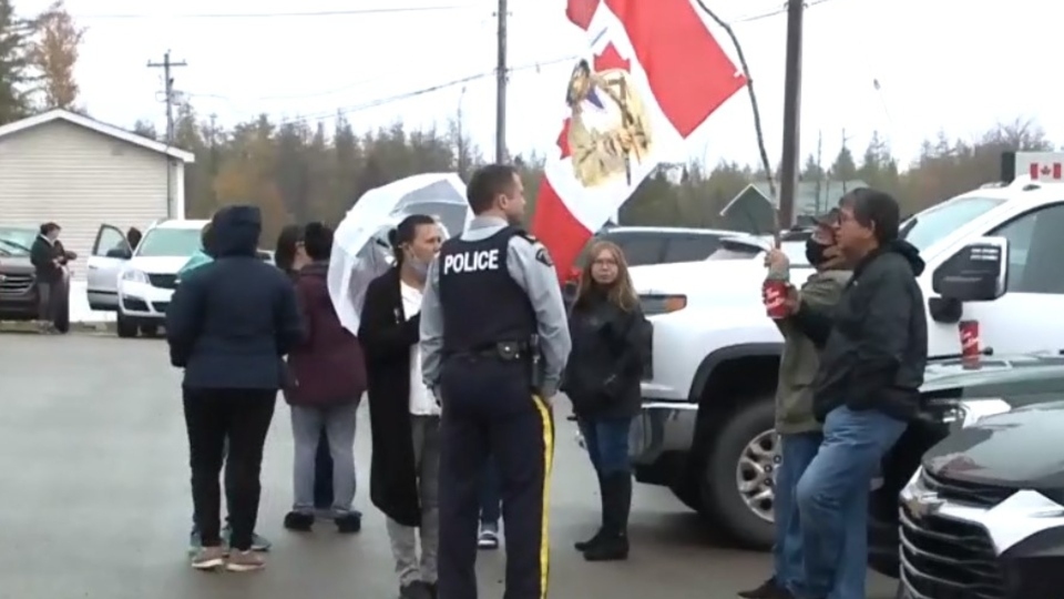 Protesters gather outside the Department of Fisheries and Oceans office in Louisdale, N.S., on Oct. 21, 2020.