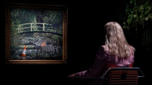 Banksy's 'Show Me The Monet' at Sotheby's auction house in London, on Oct. 16, 2020. (Alastair Grant / AP)
