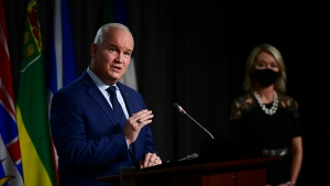 Conservative leader Erin O'Toole speaks as Conservative member of Parliament Candice Bergen looks on as they hold a press conference in Ottawa on Thursday, Oct. 22, 2020. THE CANADIAN PRESS/Sean Kilpatrick