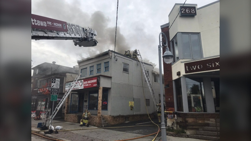 Firefighters battle a blaze at 270 Preston Street on Thursday, Oct. 22. (Photo courtesy: Twitter/OttFire)