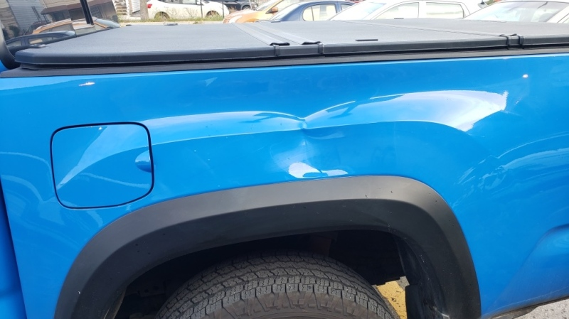 After a frustrated bus rider in Lachine kicked Vernon Rahim's truck, a sizable dent was left along with evidence of the kick courtesy of a surveillance camera. SOURCE: Vernon Rahim