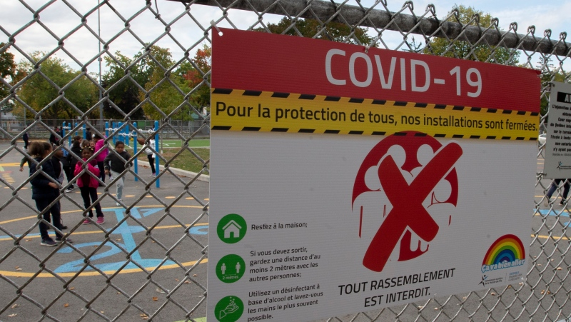 Students play in the schoolyard at an elementary school Monday, October 5, 2020 in Montreal. The Quebec government is set to announce tightened health measures for schools in the 'red zone' on its regional alert map. THE CANADIAN PRESS/Ryan Remiorz