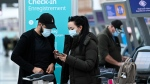 People check in at WestJet at Pearson International airport during the COVID-19 pandemic in Toronto on Wednesday, Oct. 14, 2020. THE CANADIAN PRESS/Nathan Denette
