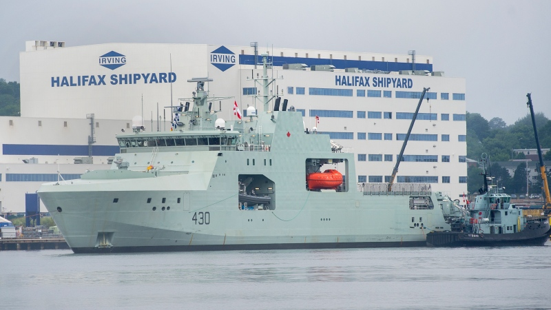 HMCS Harry deWolf heads from the Irving-owned Halifax Shipyard on its way to being delivered to the Royal Canadian Navy dockyard in Halifax on Friday, July 31, 2020. THE CANADIAN PRESS/Andrew Vaughan