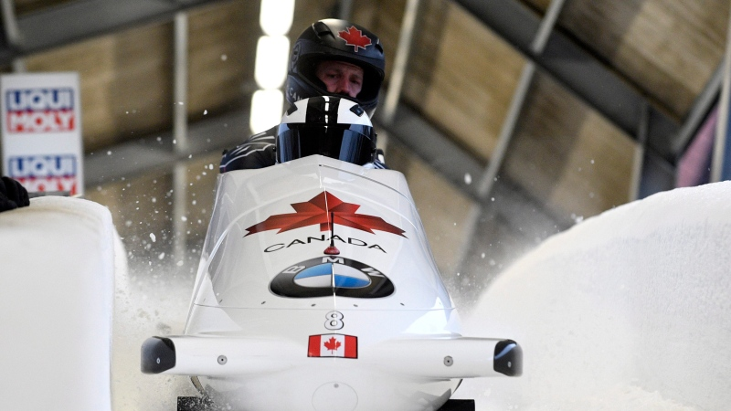Justin Kripps and Samuel Giguere of Canada finish their second run of the two-man Bobsled World Cup race in Sigulda, Latvia, Sunday, Feb. 16, 2020. Justin Kripps and Samuel Giguere placed second. (AP Photo/Roman Koksarov)