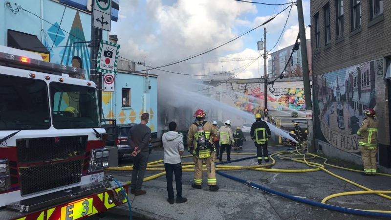 Firefighters battle a blaze in Vancouver on Thursday, Oct. 22, 2020. (Herb Ramos / CTV News Vancouver)