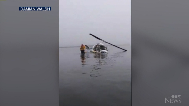 Coast Guard and local agencies rescue a pilot with minor injuries after his helicopter crashed after an attempted landing.
