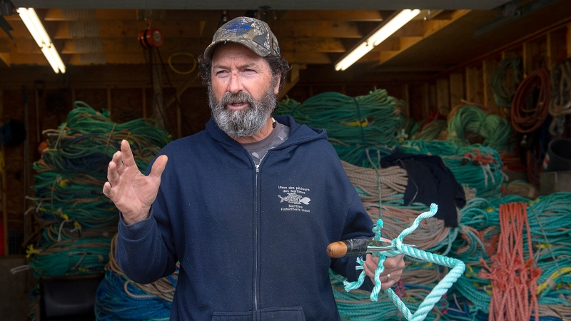 Fisherman Roger Leblanc splices some rope as he prepares for the lobster season in Meteghan, N.S. on Wednesday, Oct. 21, 2020. Tensions remain high over an Indigenous-led lobster fishery that has been the source of conflict with non-Indigenous fishermen. (THE CANADIAN PRESS /Andrew Vaughan)