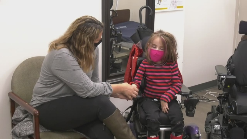 Chloe Fraser, 7, of Wasaga Beach is fitted for a specialized wheelchair on Thurs., Oct. 22, 2020 (Rob Cooper/CTV News)