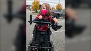 Chloe Fraser, 7, of Wasaga Beach, is fitted for a new specialized wheelchair to help her stand. (Rob Cooper/CTV News)