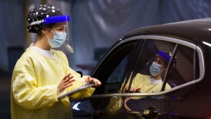 A nurse registers a patient at a drive-in COVID-19 clinic in Montreal, on Wednesday, October 21, 2020. (THE CANADIAN PRESS/Paul Chiasson)